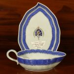 Chinese Export Armorial Sauce Boat and Under Plate, Ca. 1820